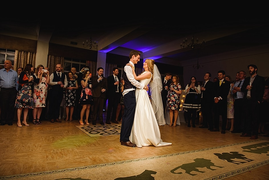 Newly married couple dance to their first song at their Bristol zoo wedding in front of the guests