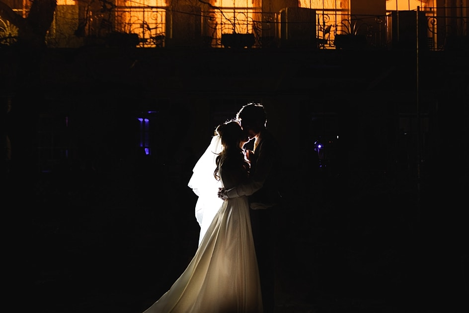 A night photo of the bride and groom in front of the Clifton Pavilion at their Bristol zoo wedding