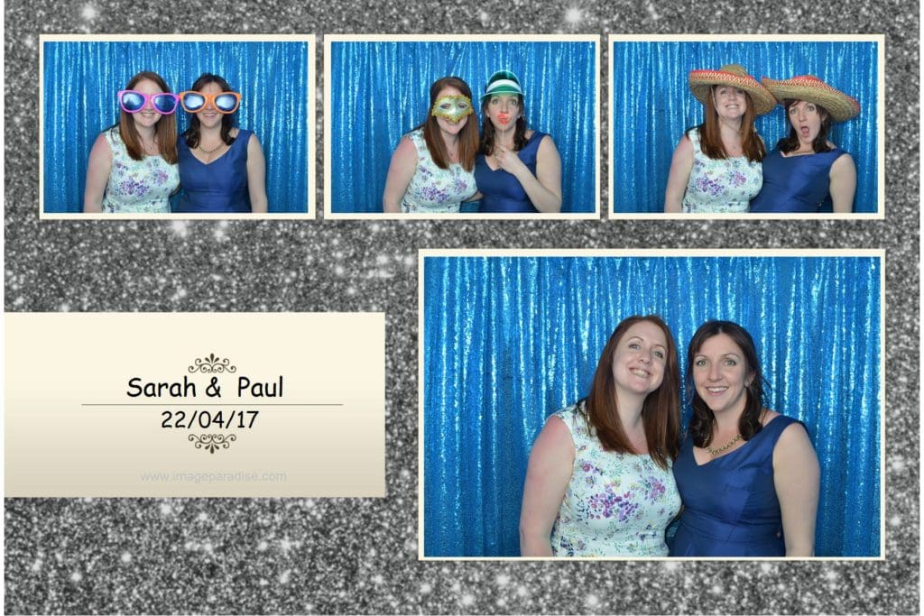 Two girls posing for their photo booth picture