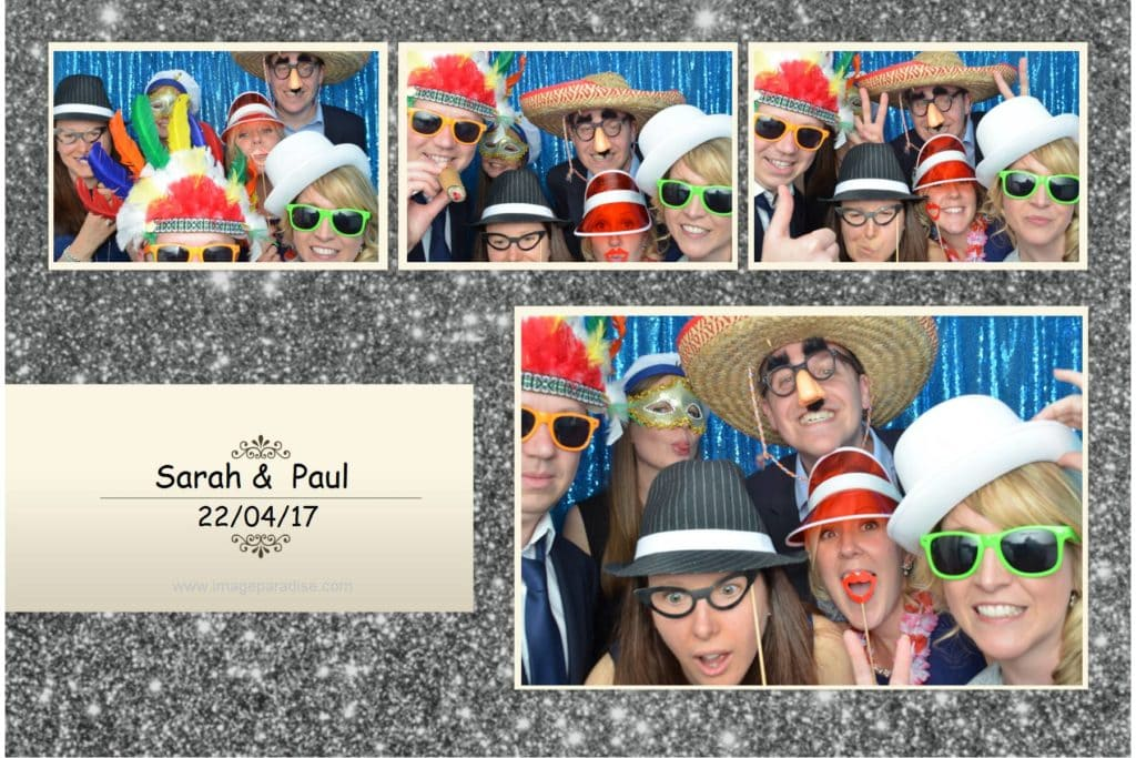 5 people dressed up in the wedding photo booth