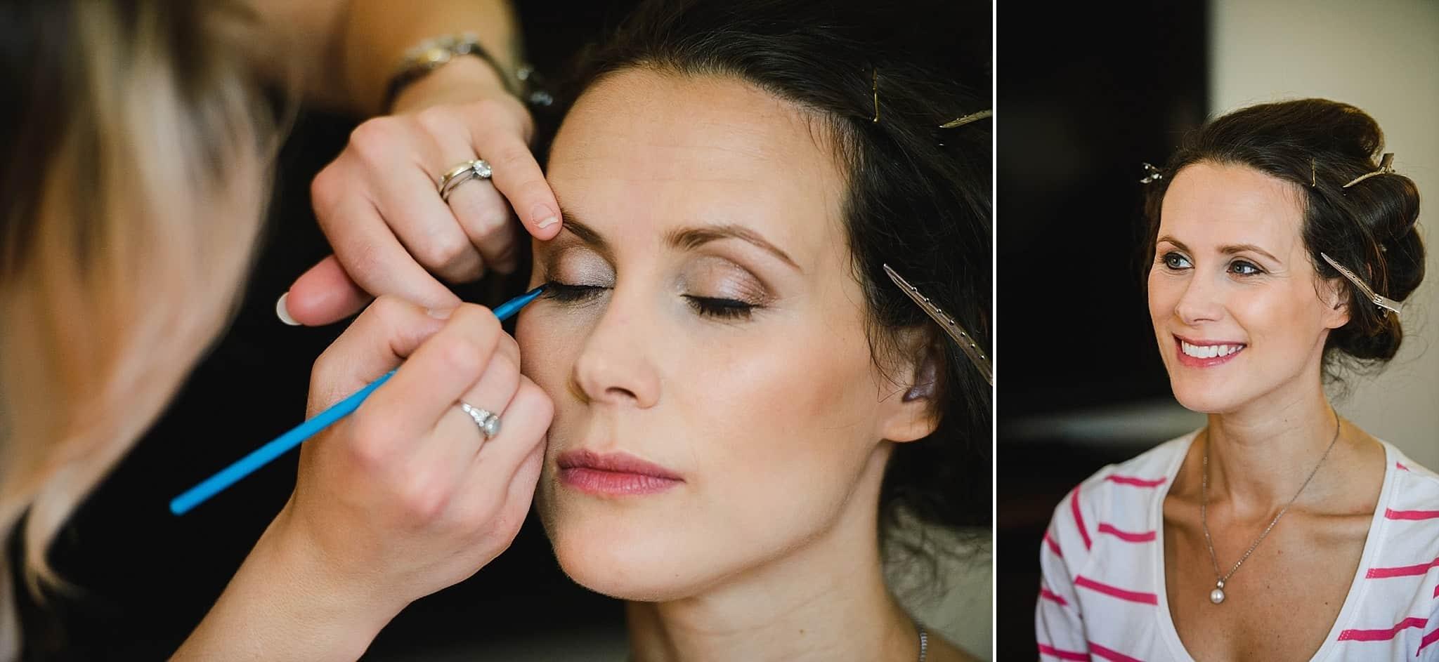 Bride having make up applied at Bail Brook House