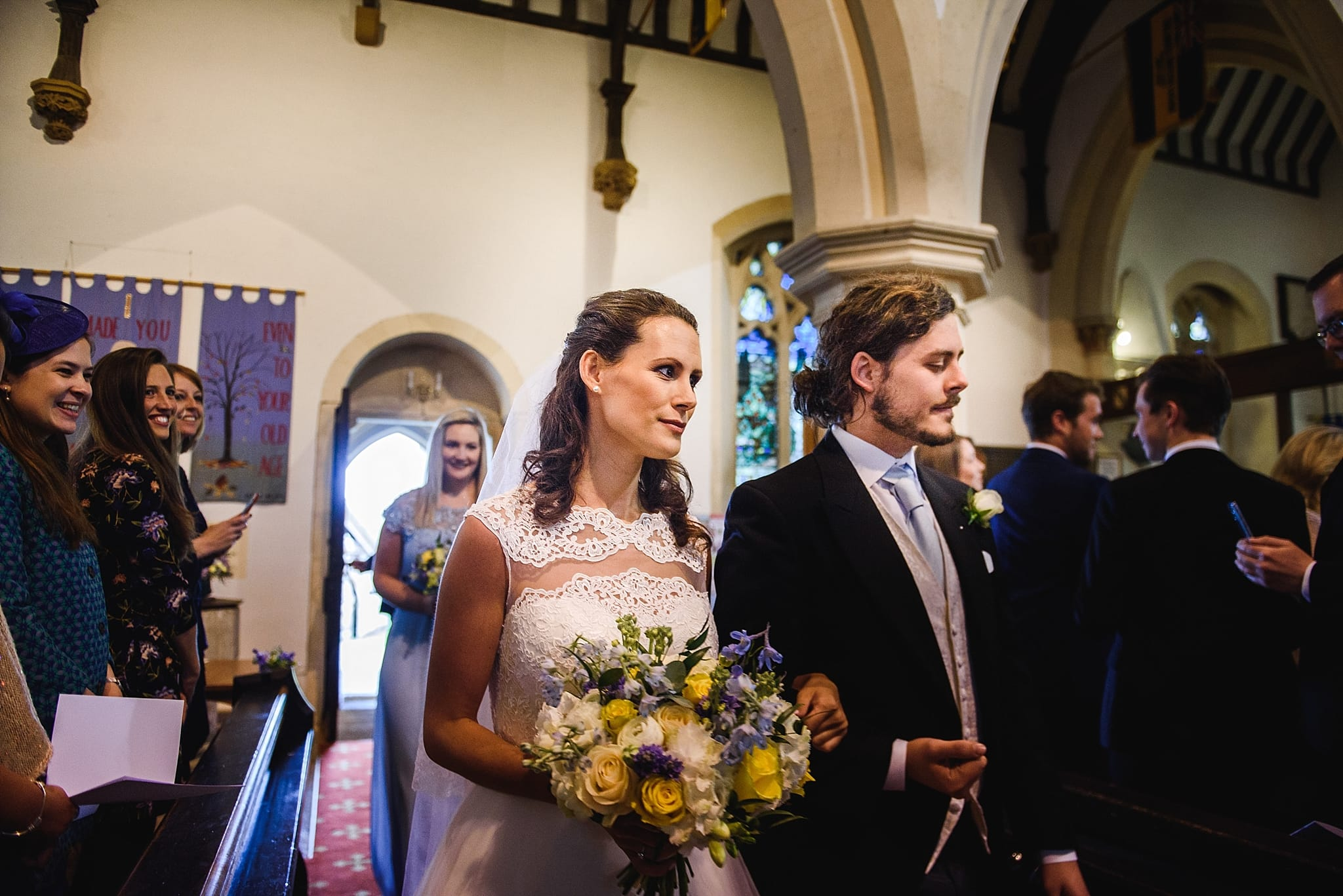 Bride walking down the aisle at St Swithins church, Bathford