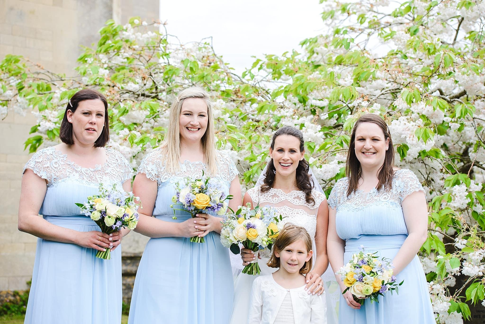 Bridesmaids pose outside of St Swithins church, Bathford