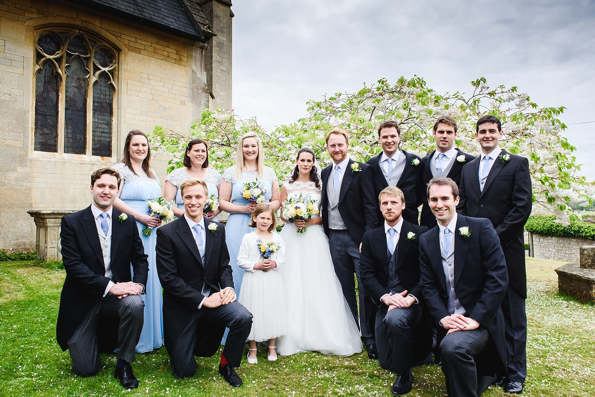 Mixed wedding party photo outside St Swithins church, Bathford
