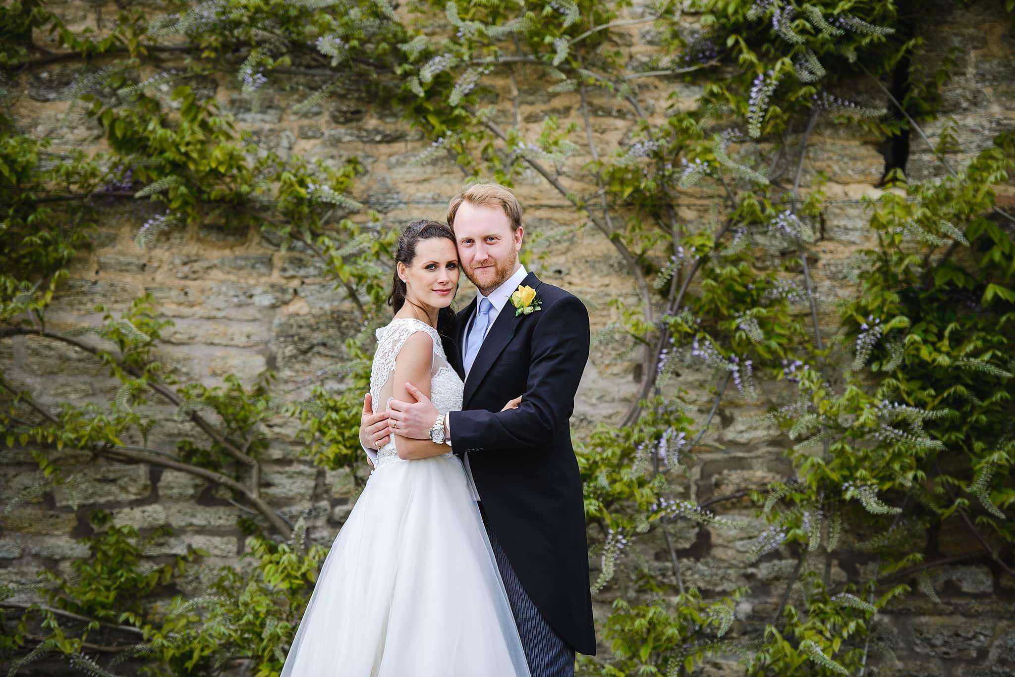 A couple have photos on their wedding day