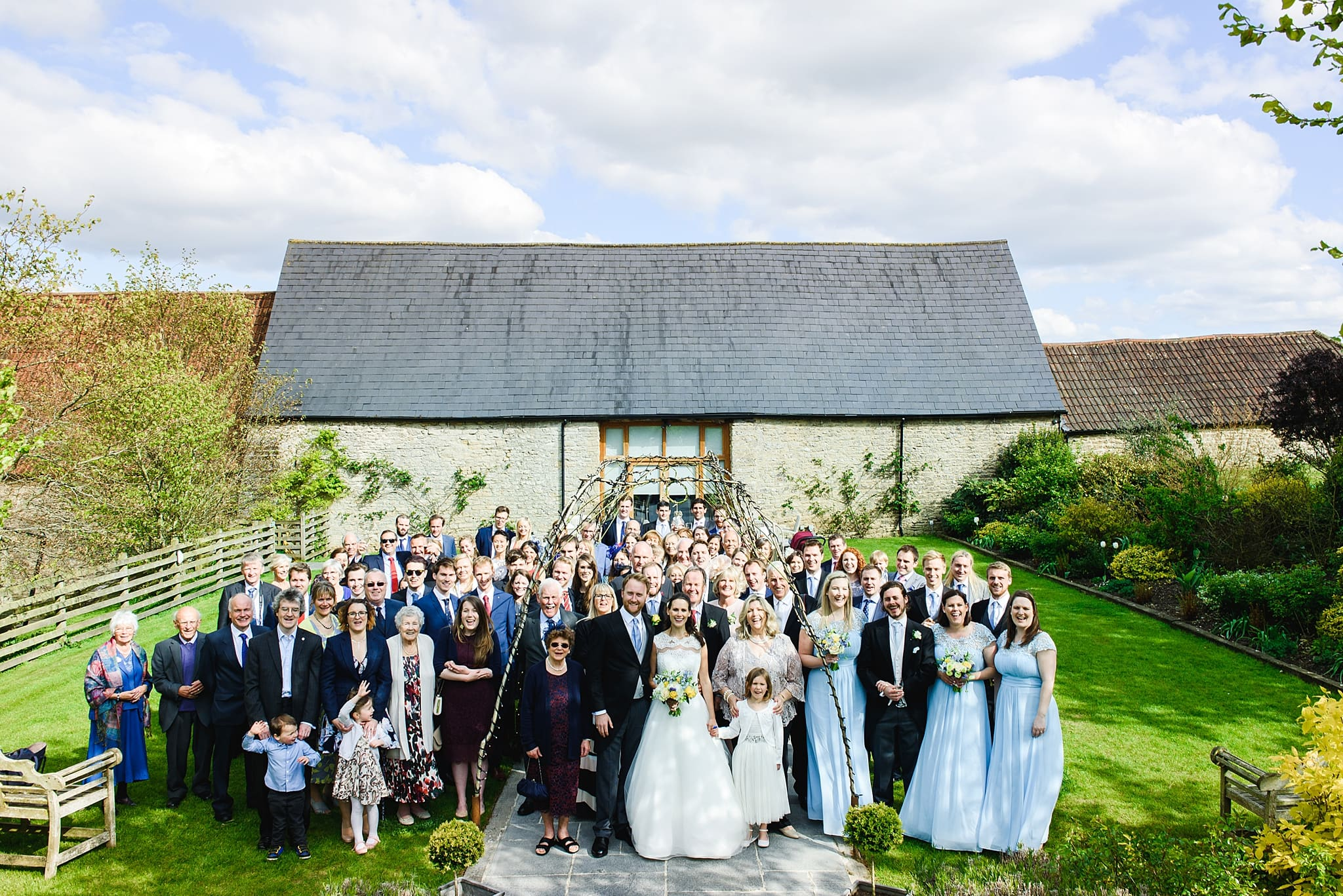 Group photo of a wedding party at Wick Farm in Bath