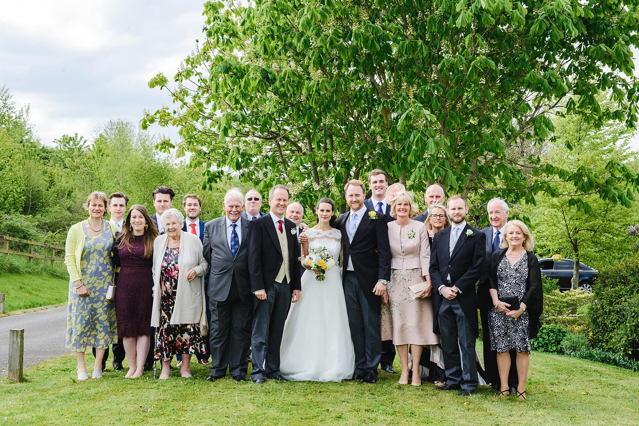 A formal family photo on a wedding day at Wick Farm Bath