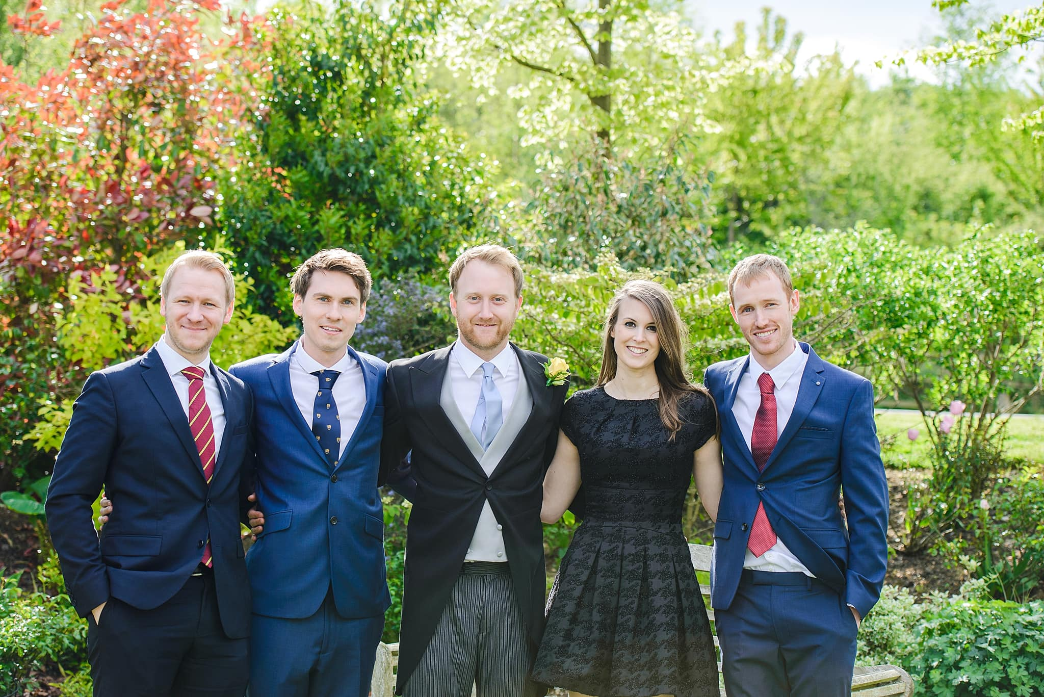 A group of friends pose with the Groom on his wedding day at Wick farm