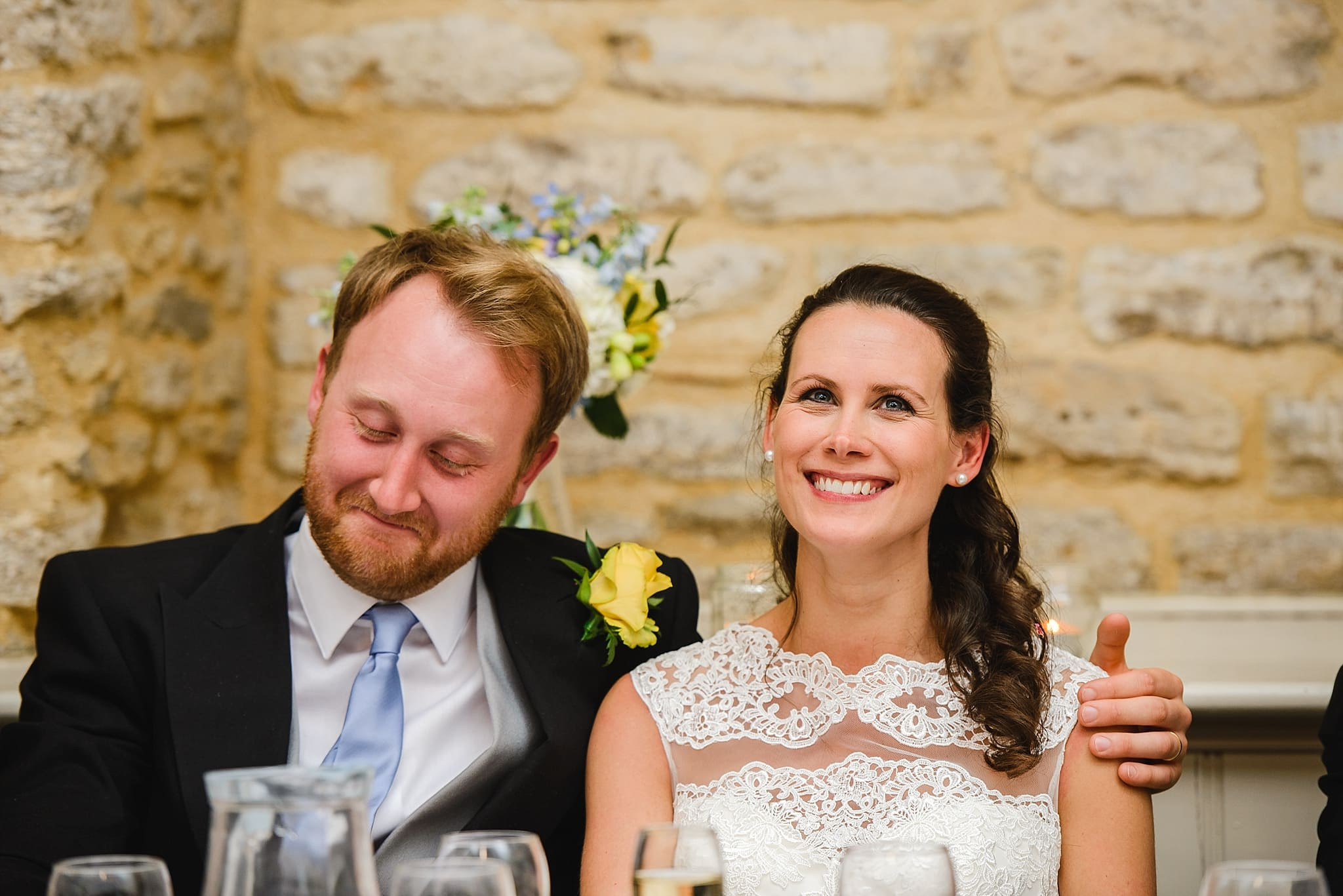 Bride and groom laughing at their wedding speeches at Wick Farm