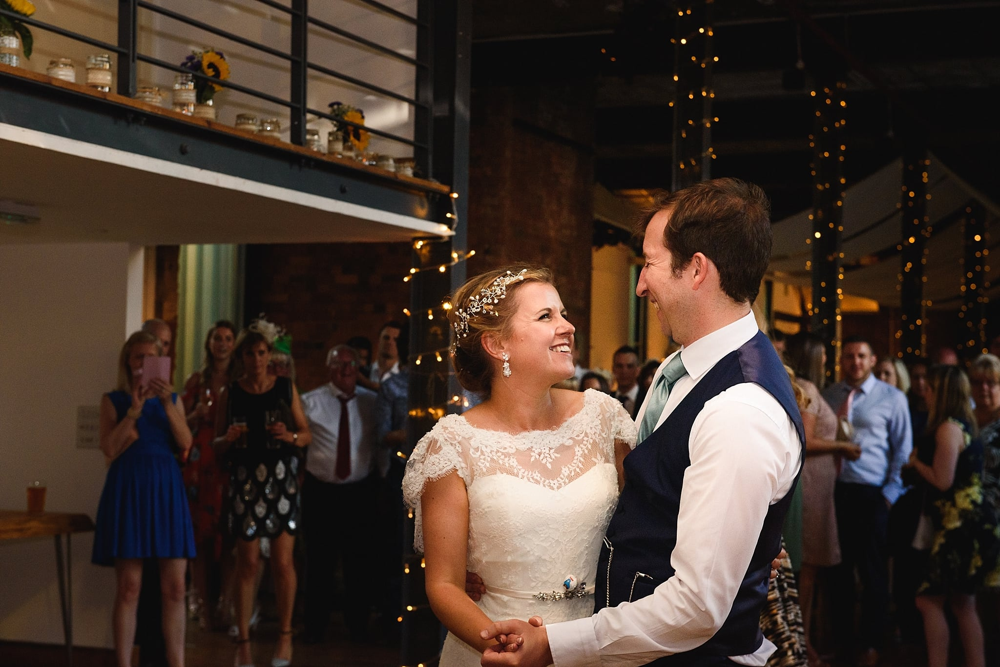 Couple have their first dance on the dance floor of the Paintwork's event space