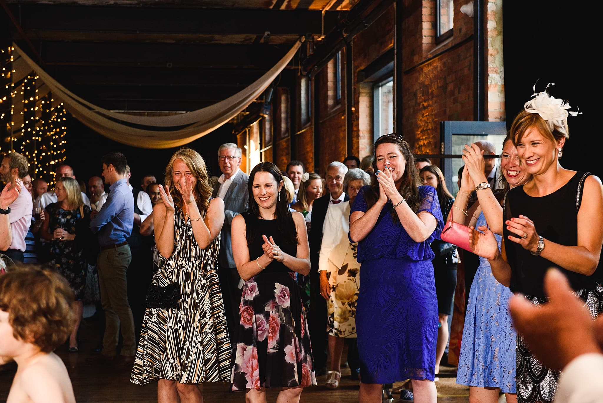 guests applaud couple after their first dance
