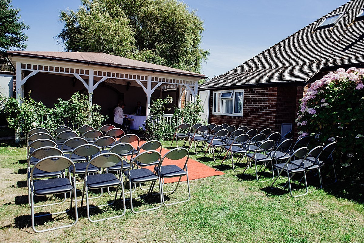 Photo of the garden set up with chairs ready for an outdoor wedding ceremony at the Beachlands hotel WSM