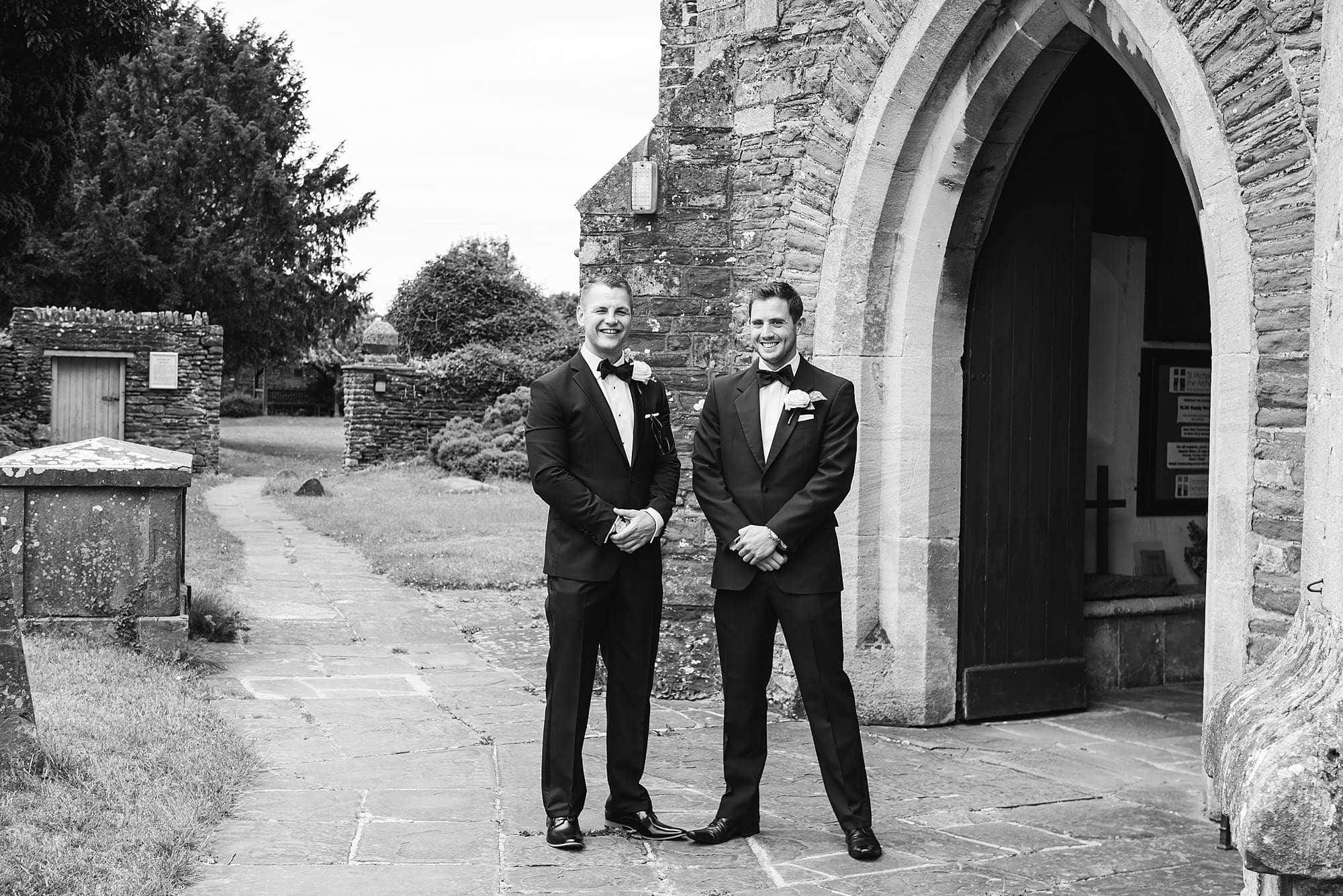 Groom and best man stood outside church