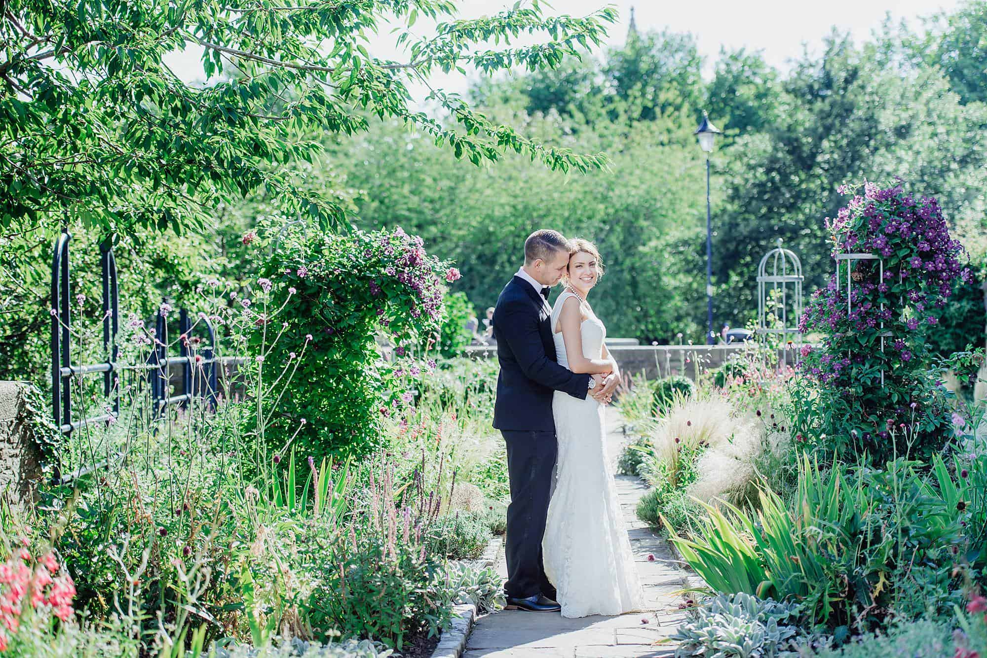 Full length shot of bride and groom in Castle park Bristol taken by Bristol wedding photographer