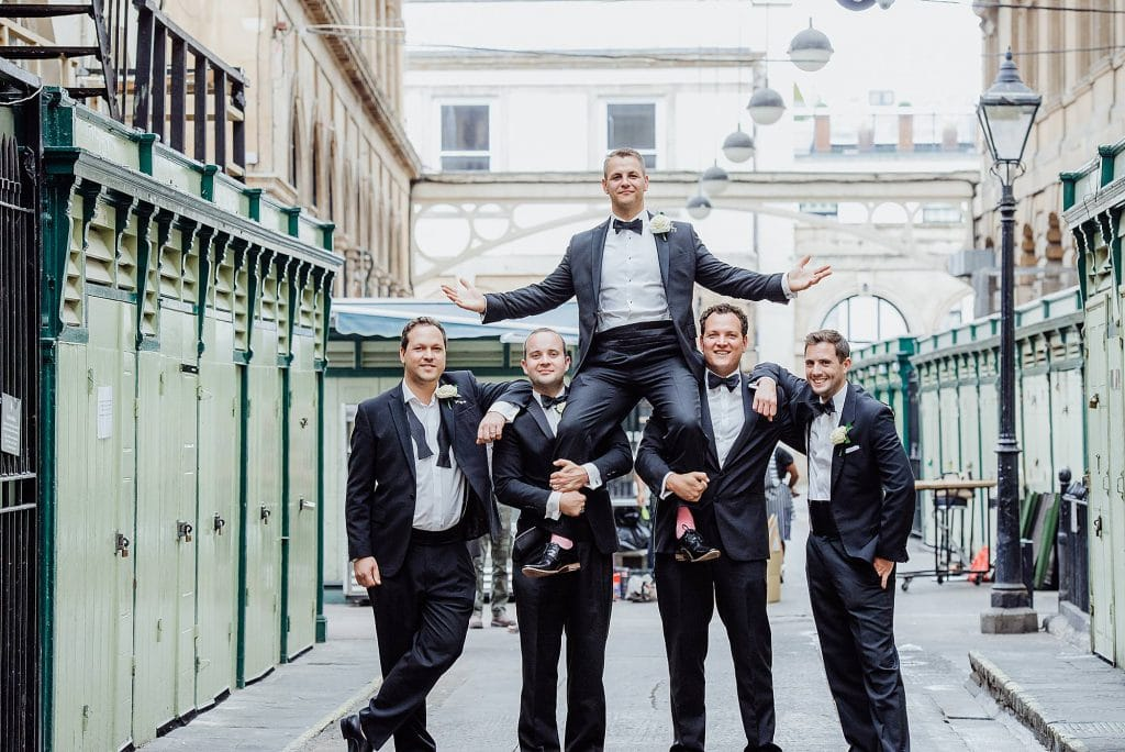 Groom sitting on the shoulders of his groomsmen outside the Rummer Hotel Bristol