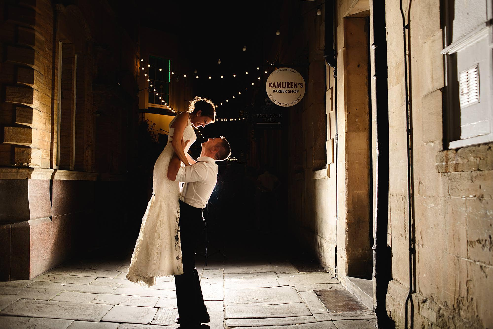 groom picks up his bride at night outside their Rummer hotel wedding Bristol
