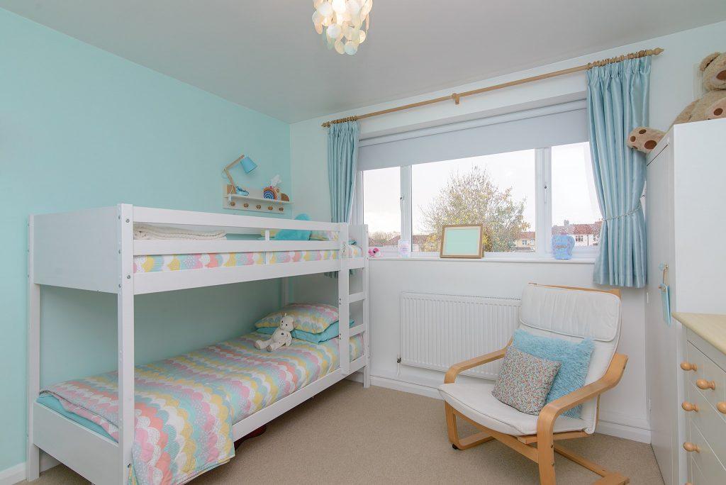 kids room with bunk beds.