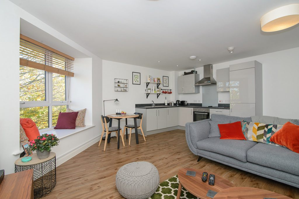 Open plan living area with sofa area, dining table and kitchen. Bristol property photography