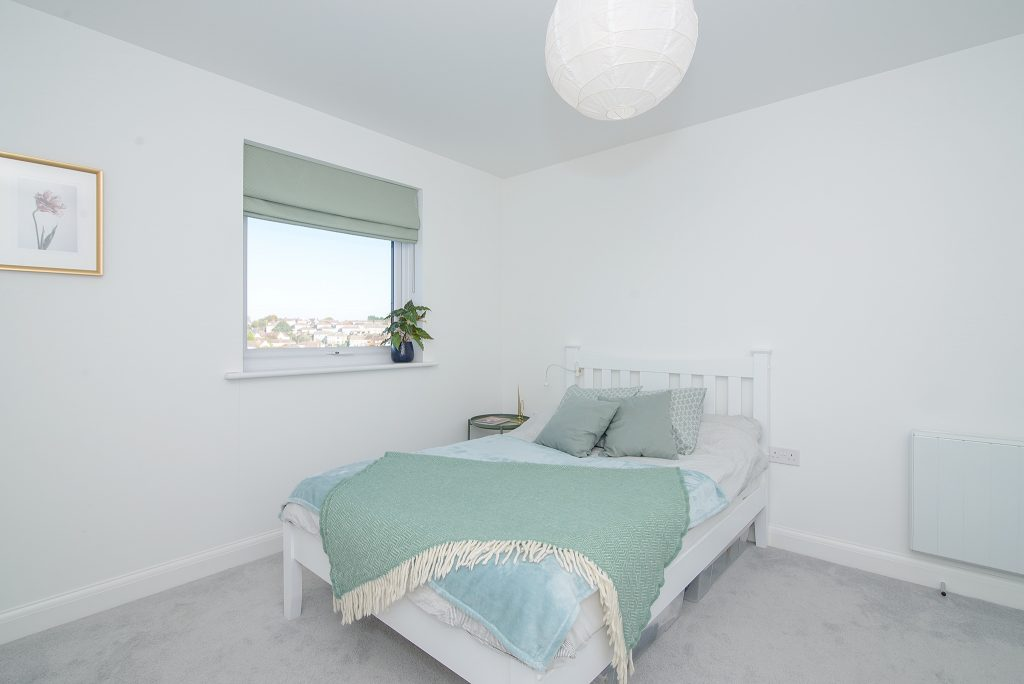 A minimalist property photograph of a bedroom Bristol