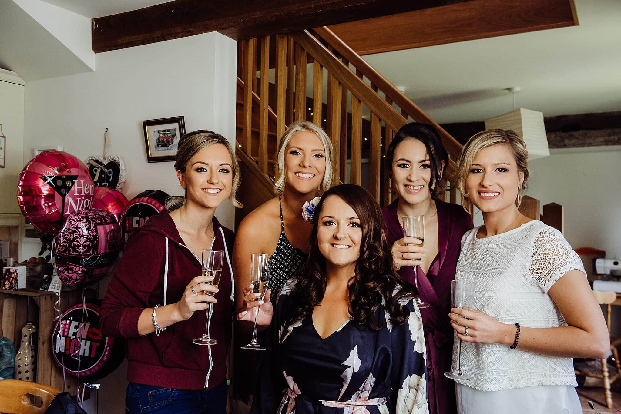 Bridesmaids making a toast in the bride kitchen before her wedding