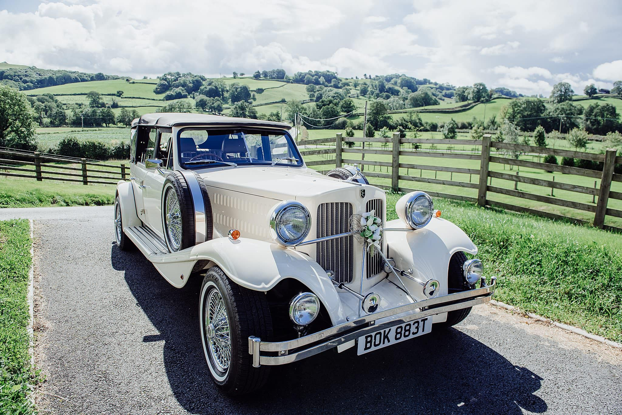 Old vintage wedding car with Welsh hills in the background