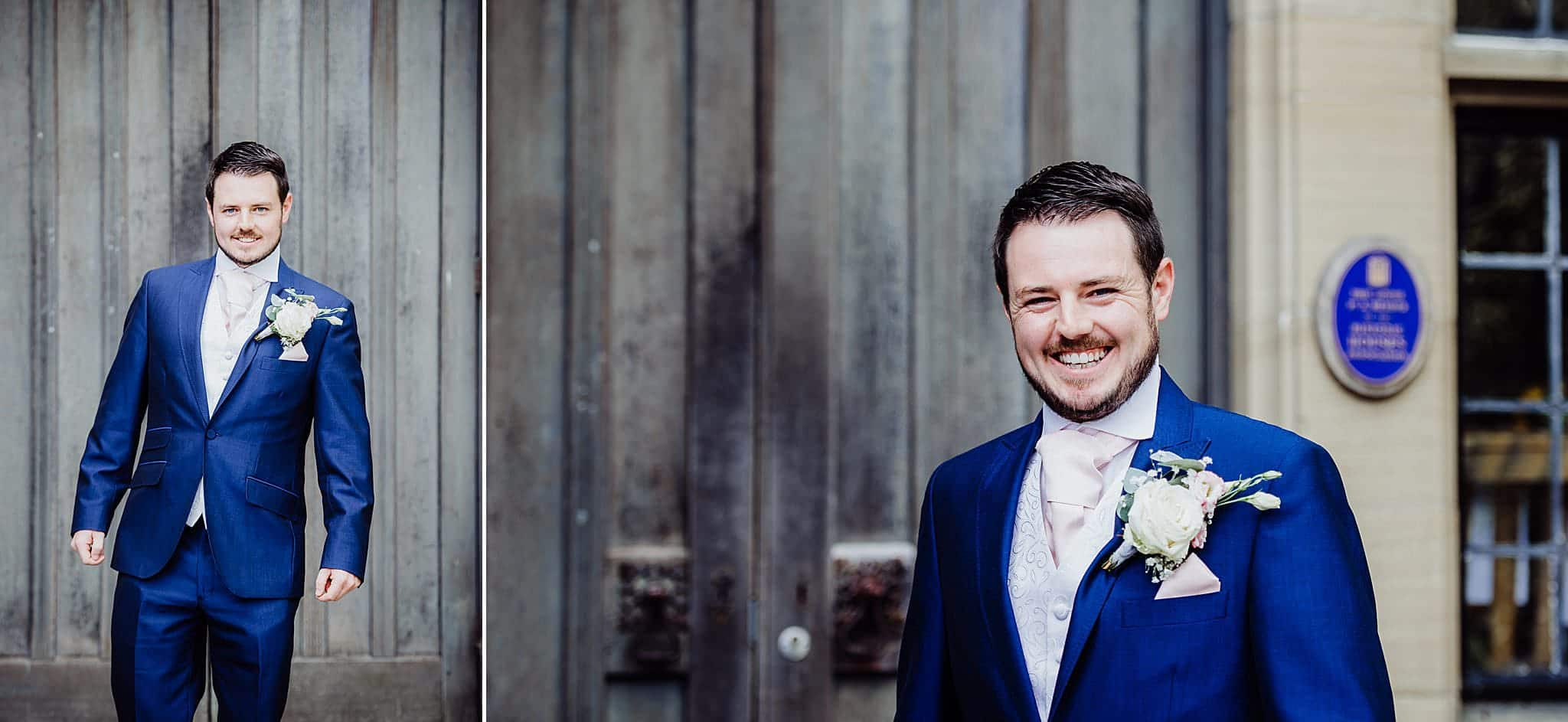 Portraits of the groom stood in front of grey wood gates at Gregnog Hall wedding venue