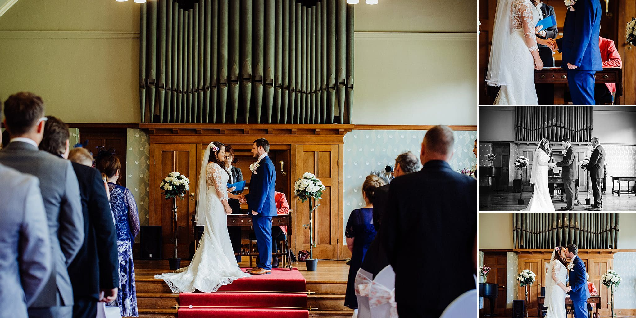 Bride and groom stood in front of the organ holding hands during their wedding ceremony at Gregnog Hall