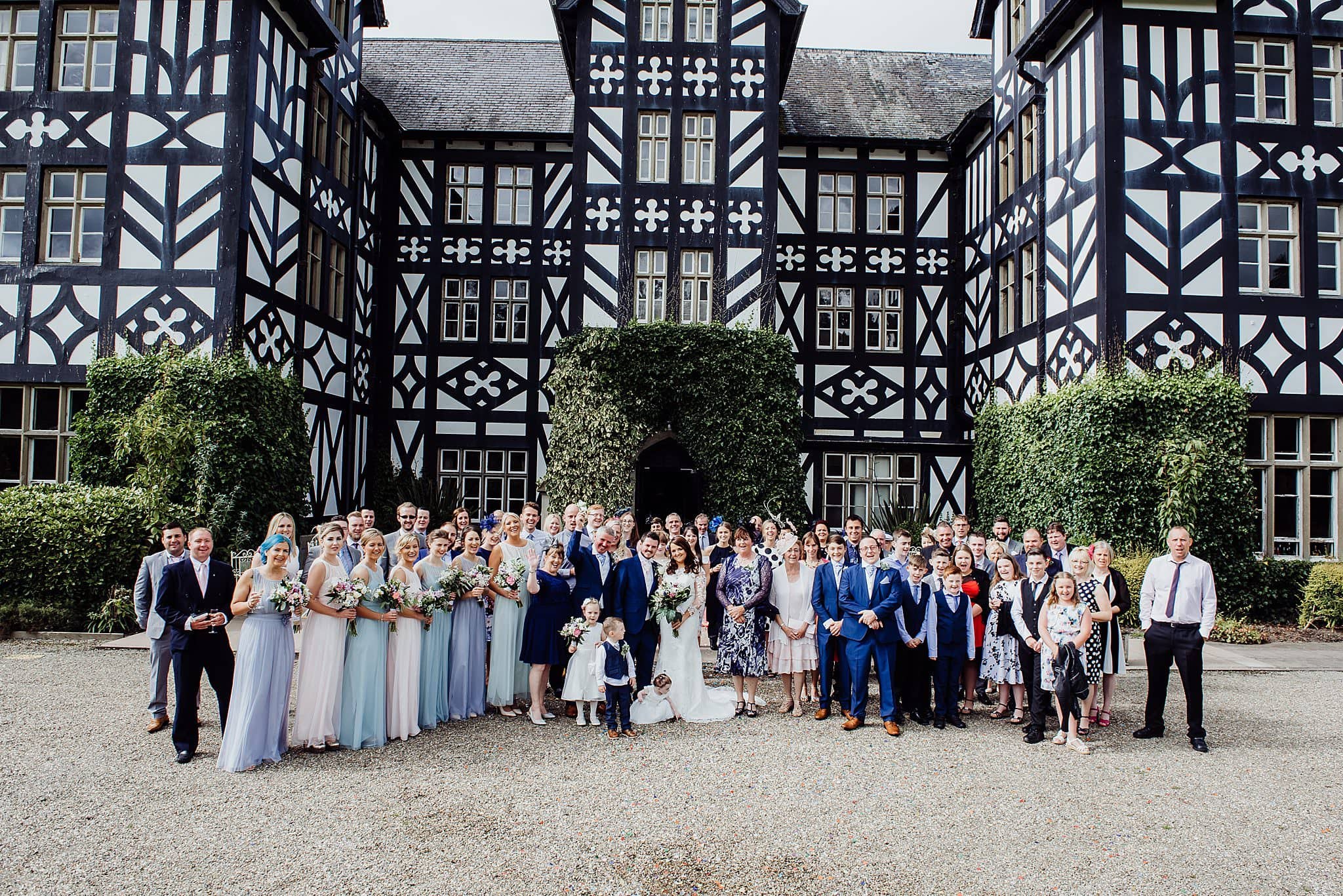 Large group shot of the wedding guest in front of the house at Gregnog Hall