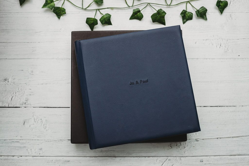 Blue leatherette wedding album sat on the box it comes in