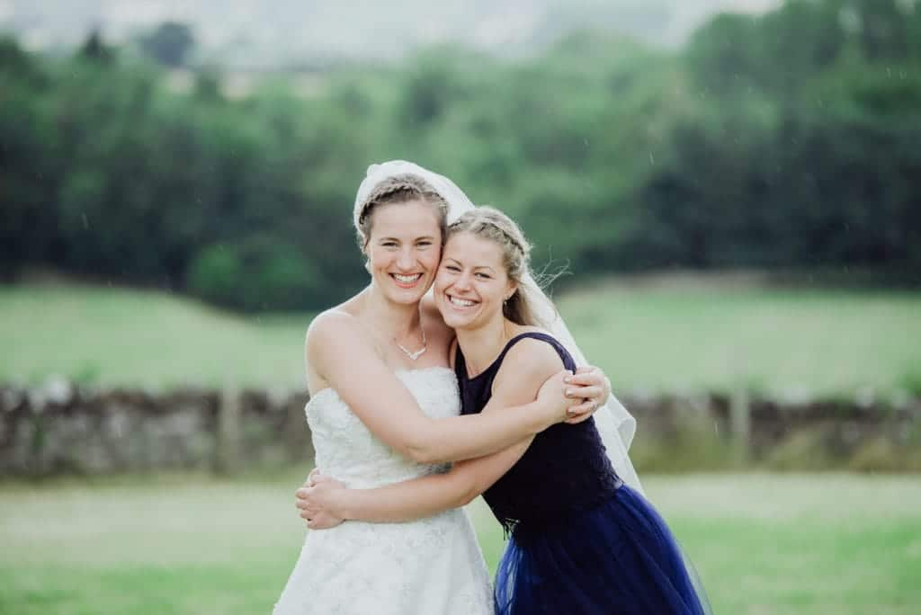 bride and her sister cuddle