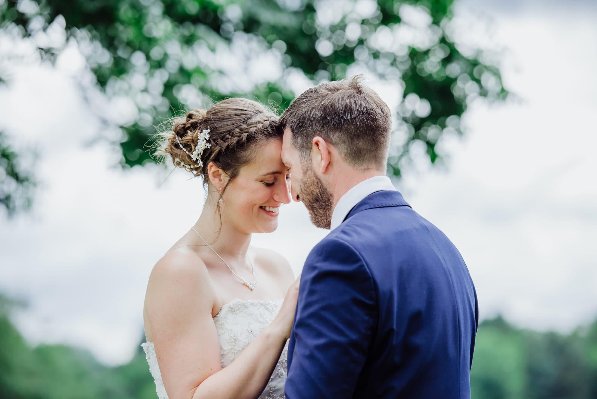 wedding photo of bride and groom head to head