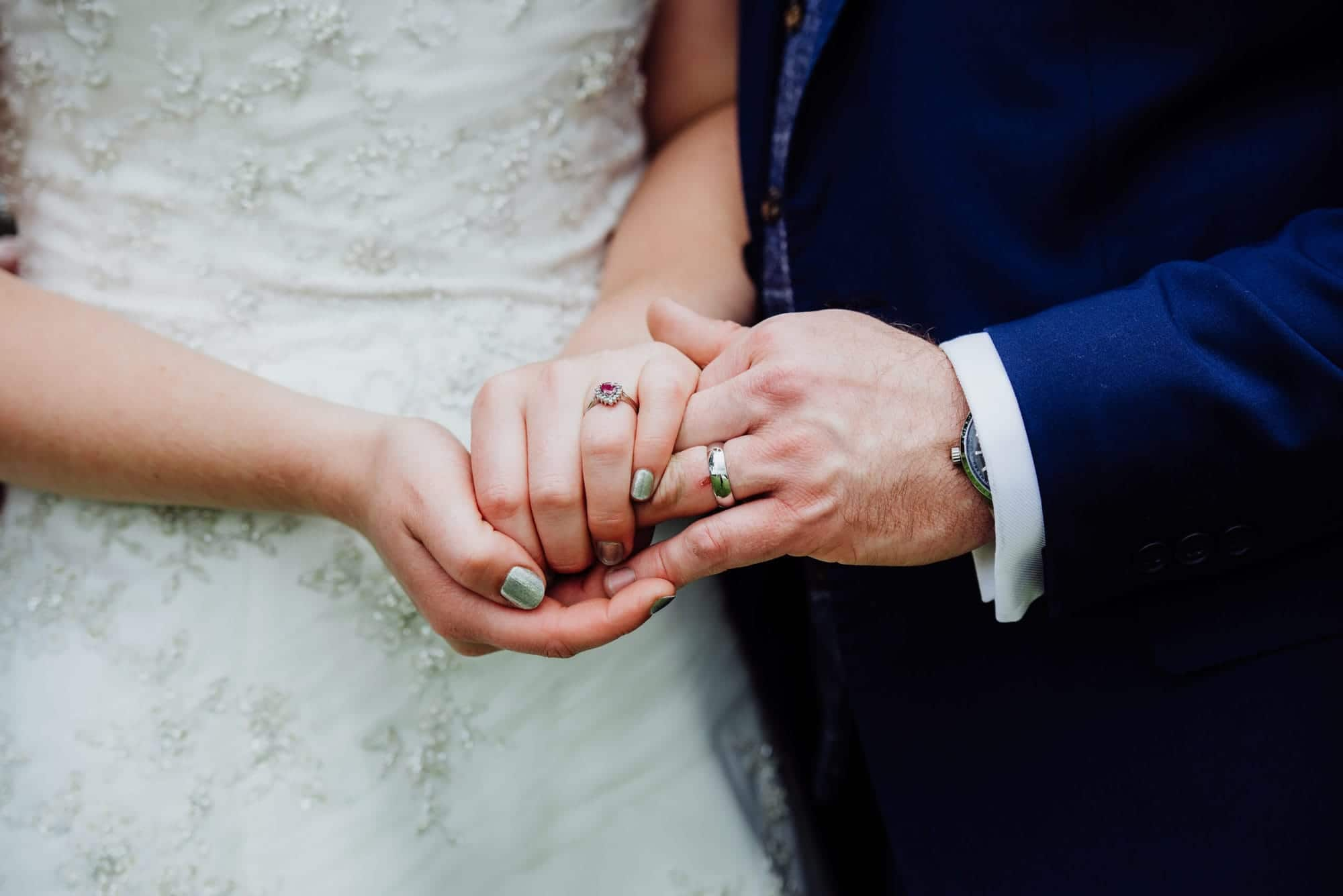 couple showing off they wedding rings