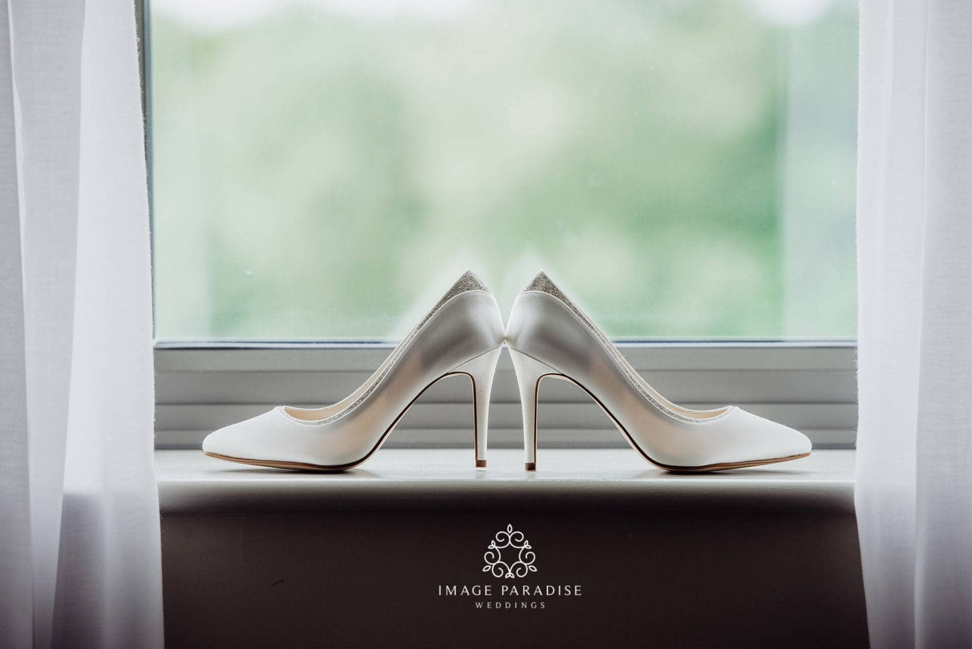 Brides wedding shoes in the window of Cotswolds Hotel Spa wedding venue