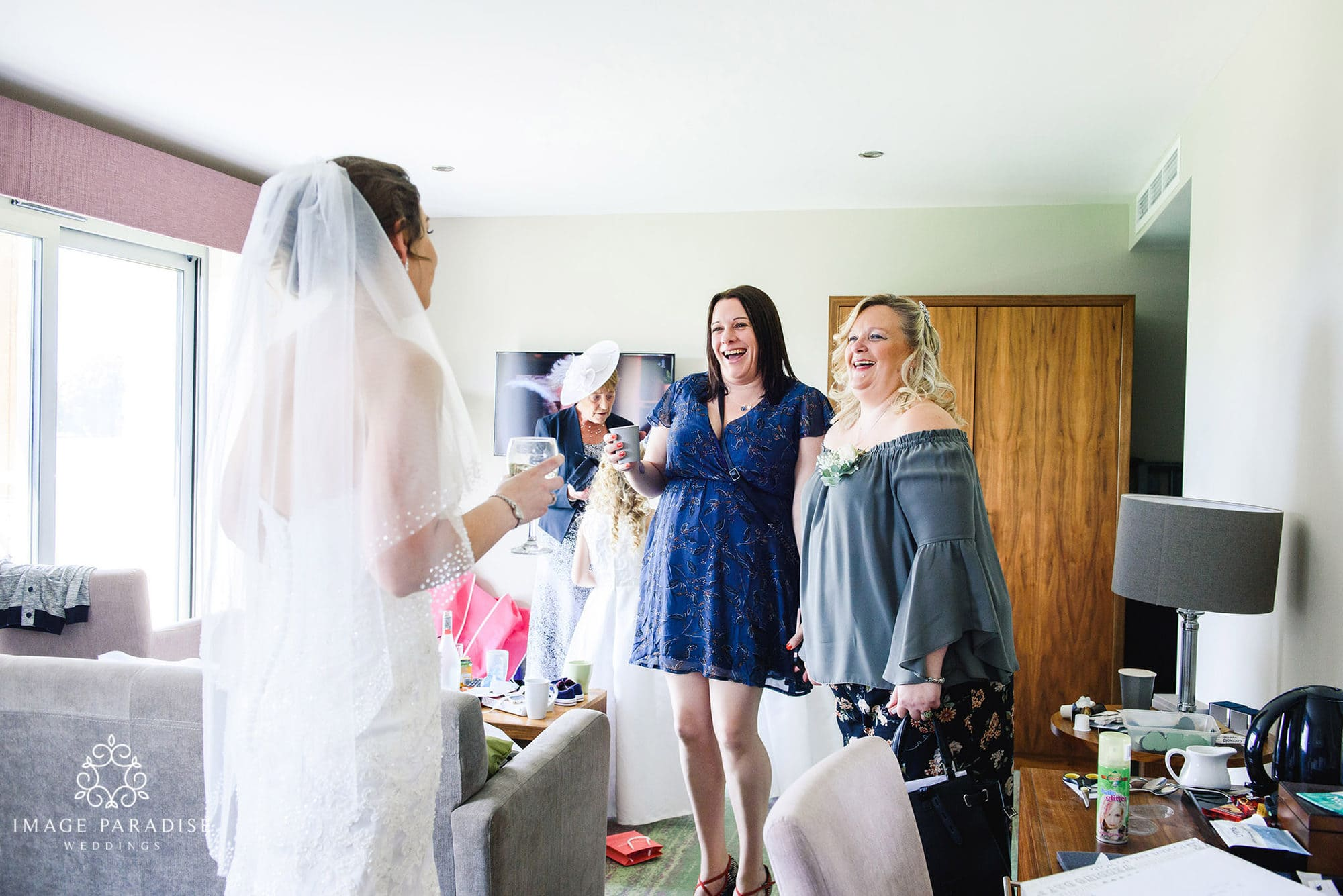 bride reveals her dress to her friends