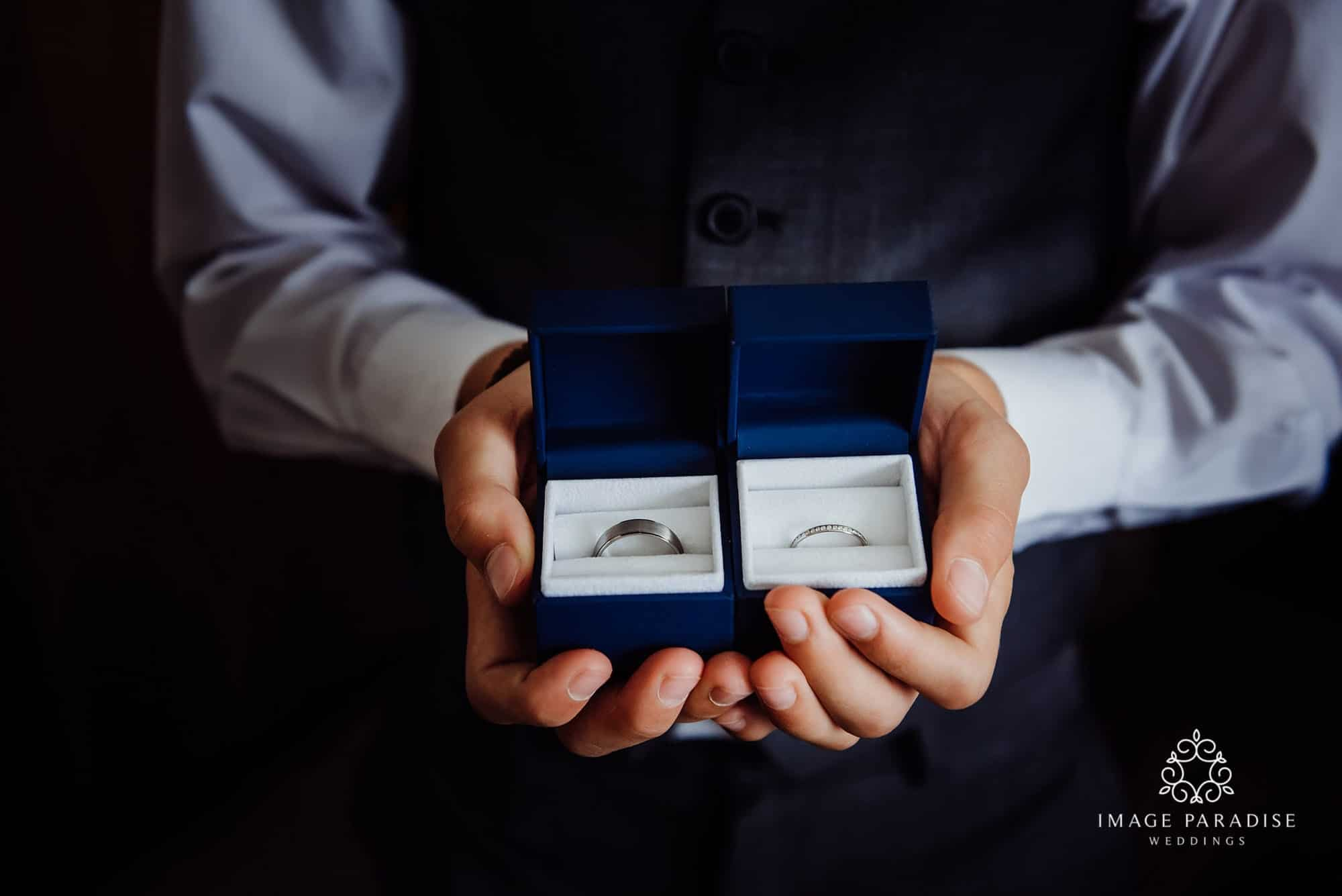 Paige boy holding the wedding rings at the Cotswolds hotel and spa wedding venue