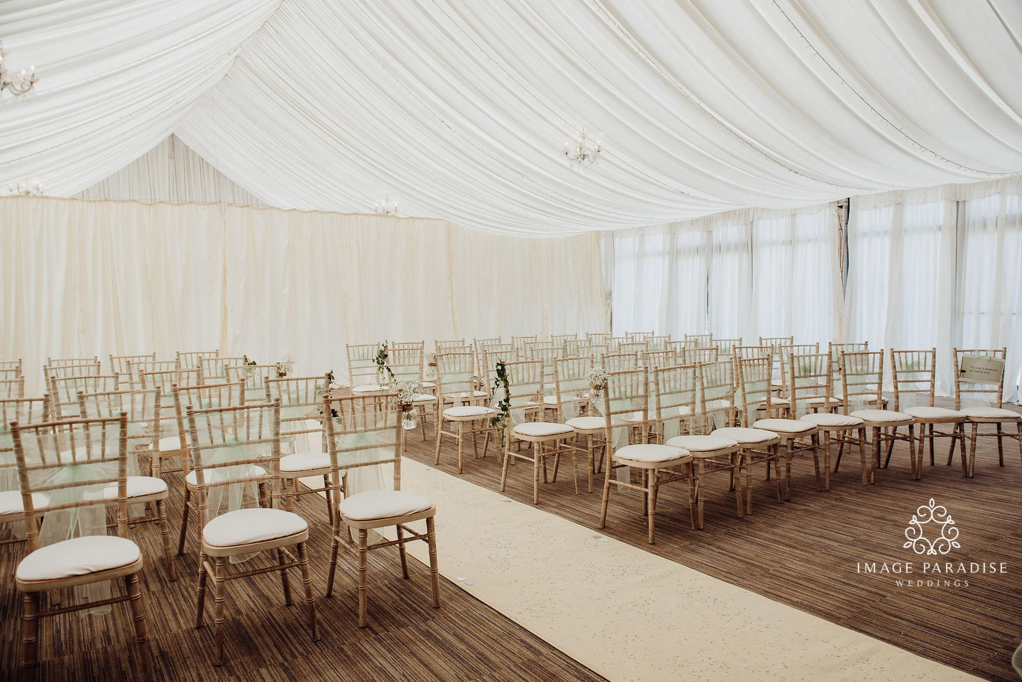 Cotswolds wedding venue chairs inside marquee for wedding ceremony
