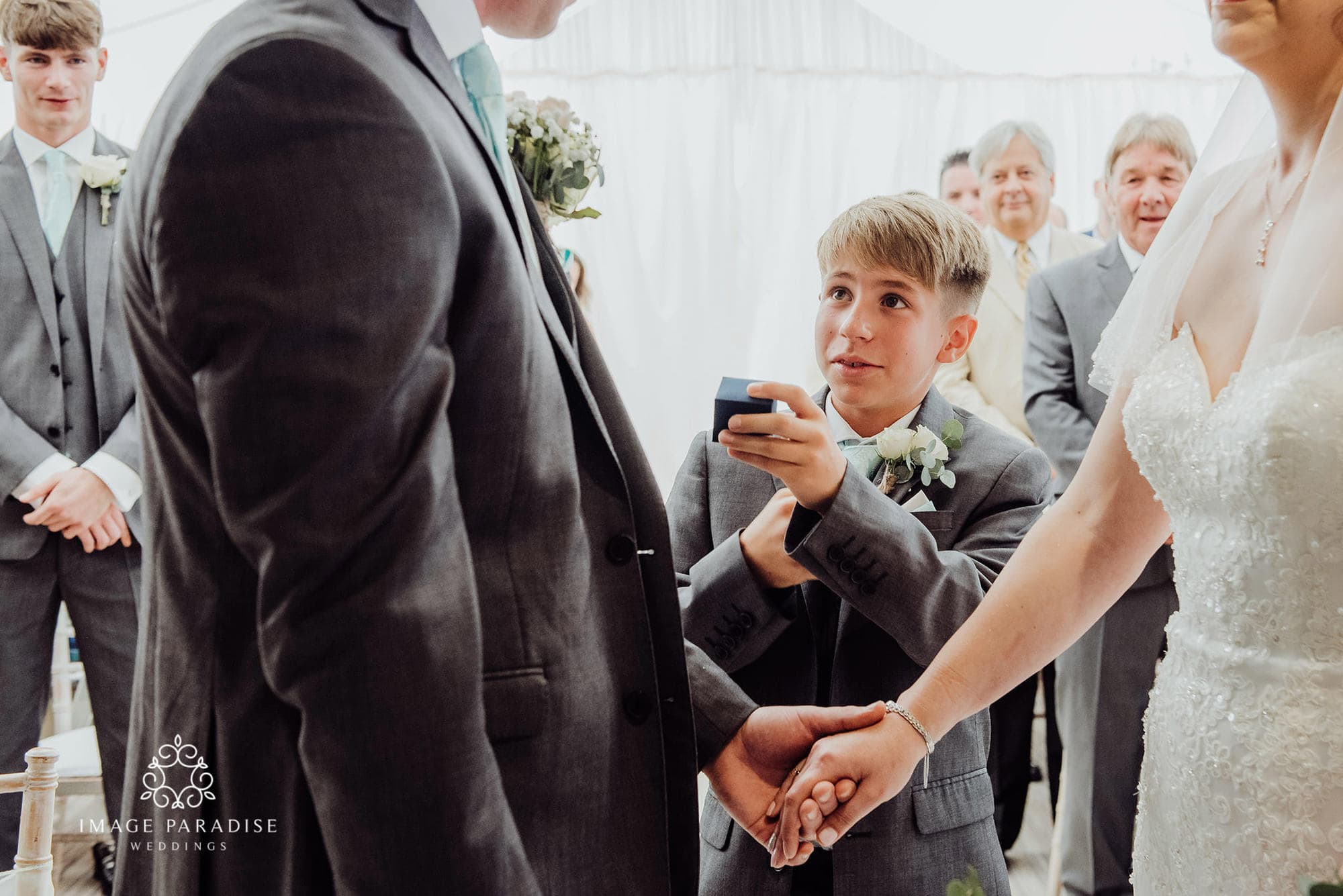 Paige boy holds out ring during the ceremony at Cotswolds hotel and spa