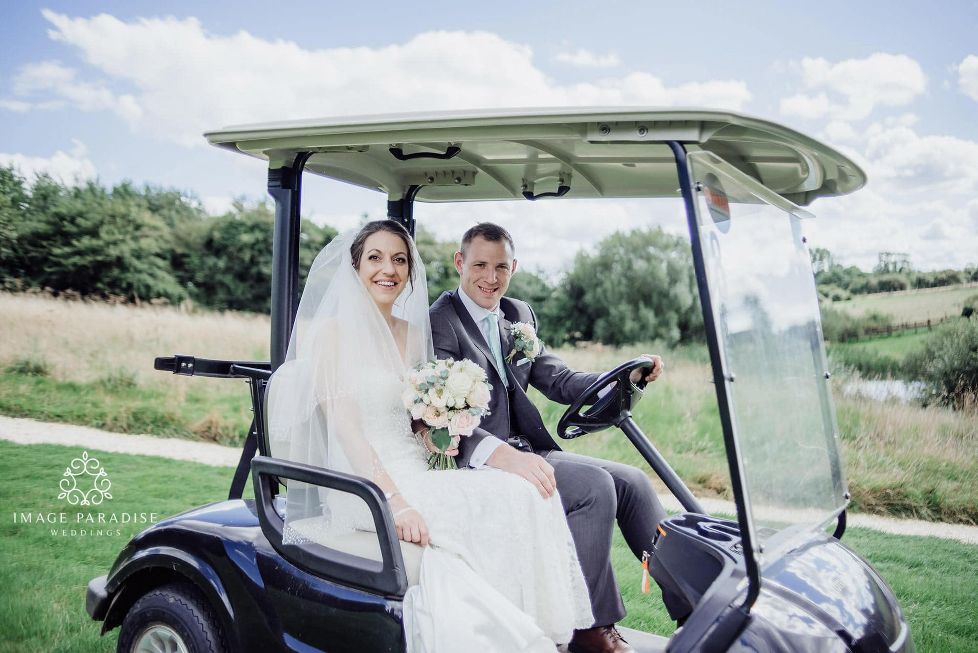 bride and groom in a golf buggy at the Cotswolds hotel and spa wedding photography