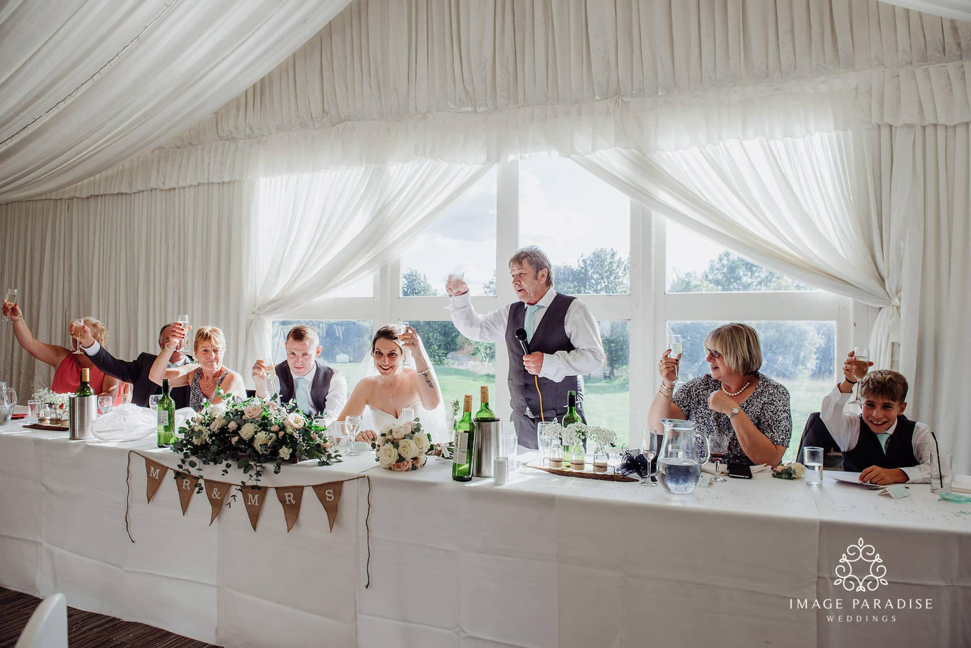Cotswolds hotel and spa wedding photographers of the toasts
