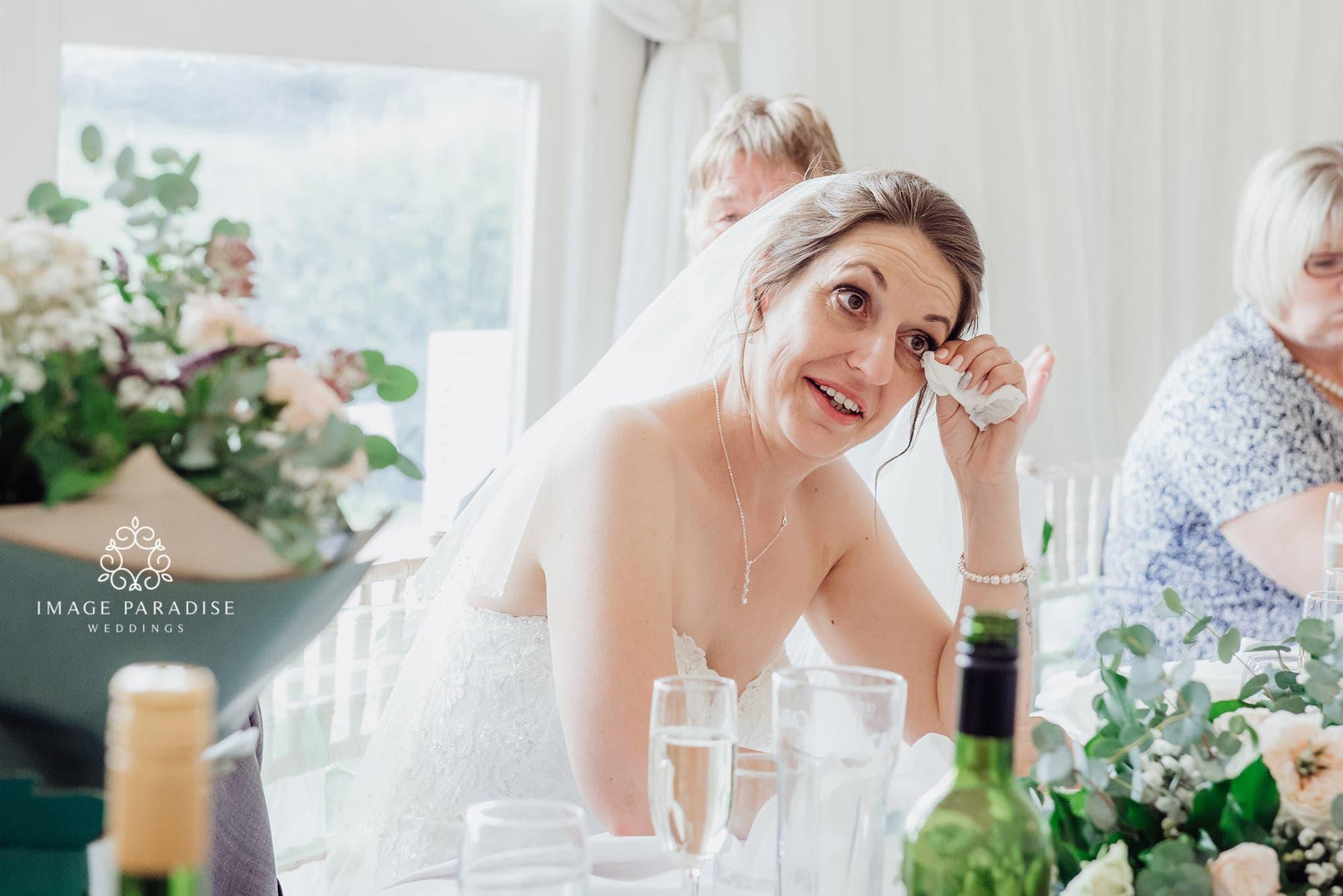 documentary wedding photography at Cotswolds hotel and spa where bride cries at the speeches
