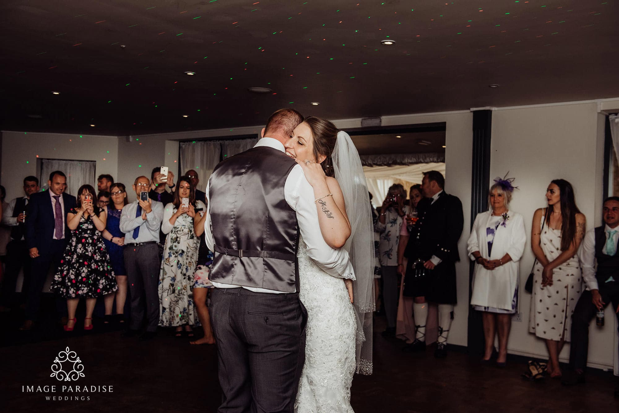 bride and groom slow dance Cotswolds hotel wedding photographers