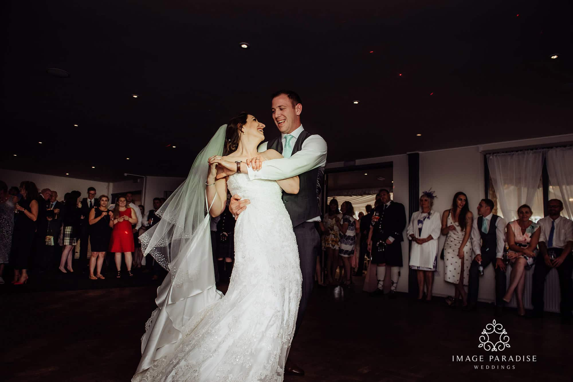 the first dance where groom spins his bride on the dance floor at the Cotswolds hotel and spa