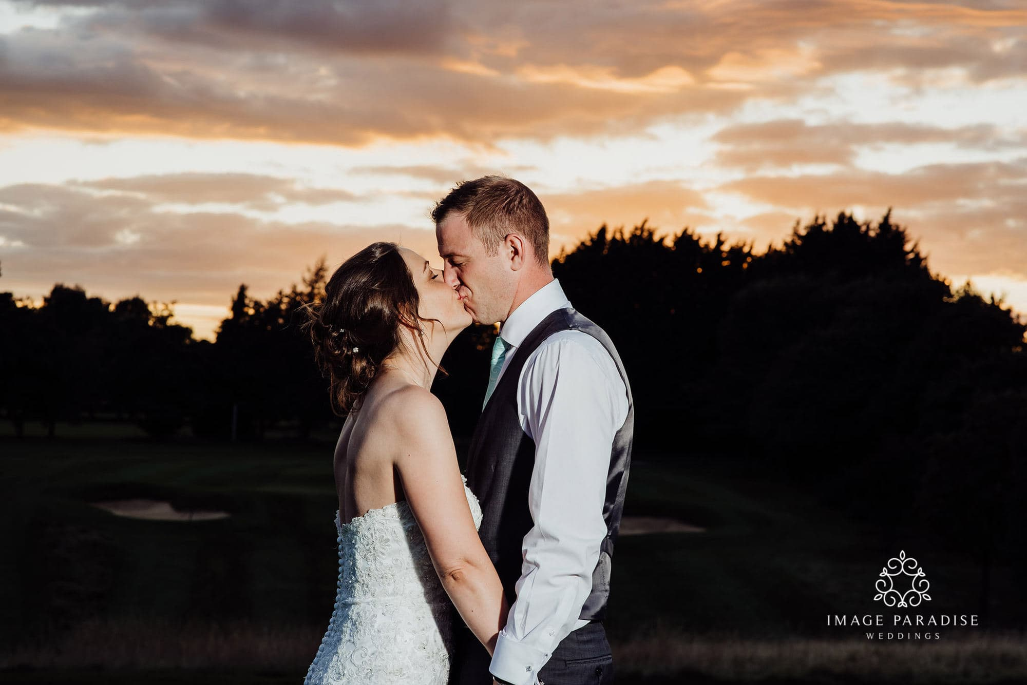 sunset kiss at the Cotswolds hotel and spa wedding photography