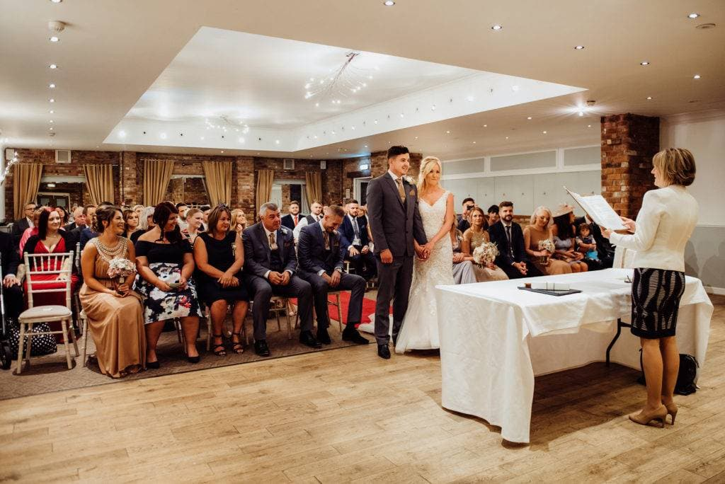 wedding ceremony in the moat suite at Hatherley Manor