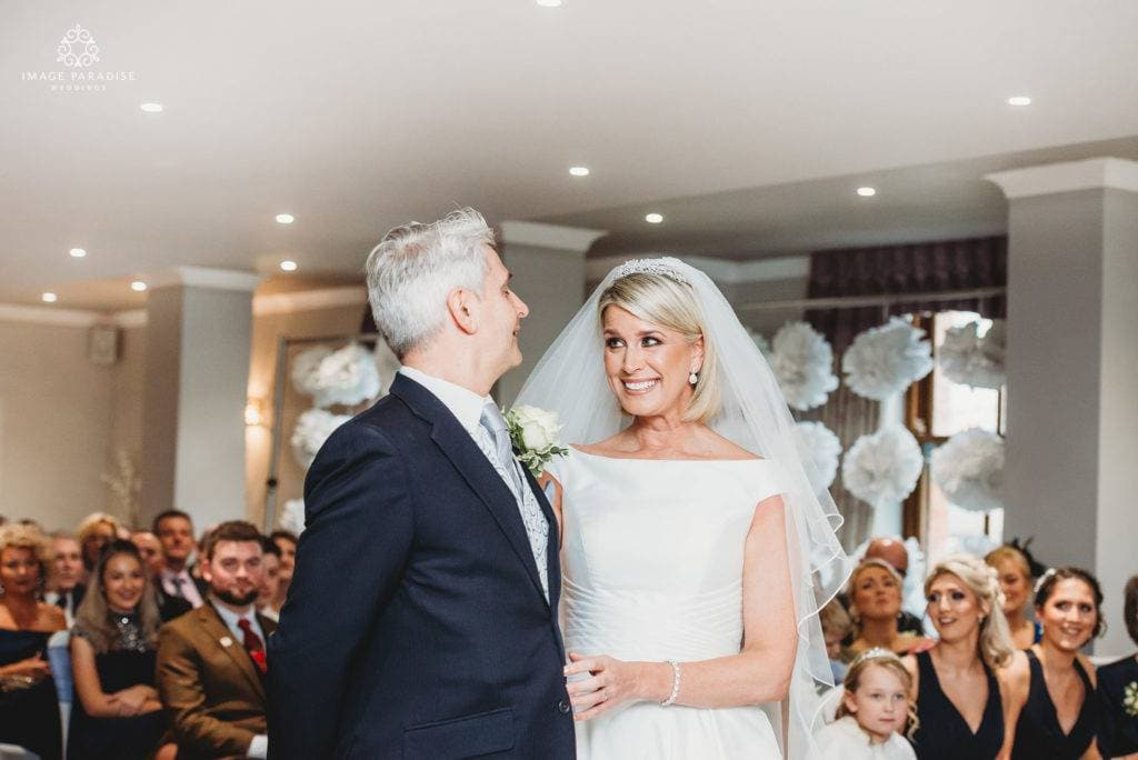 bride and groom getting married in the Mulberry suite at Hatherley Manor Hotel