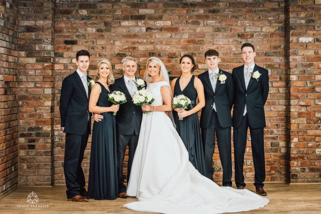 Indoor family photo at Hatherley manor Moat suite by wedding photographer Image Paradise