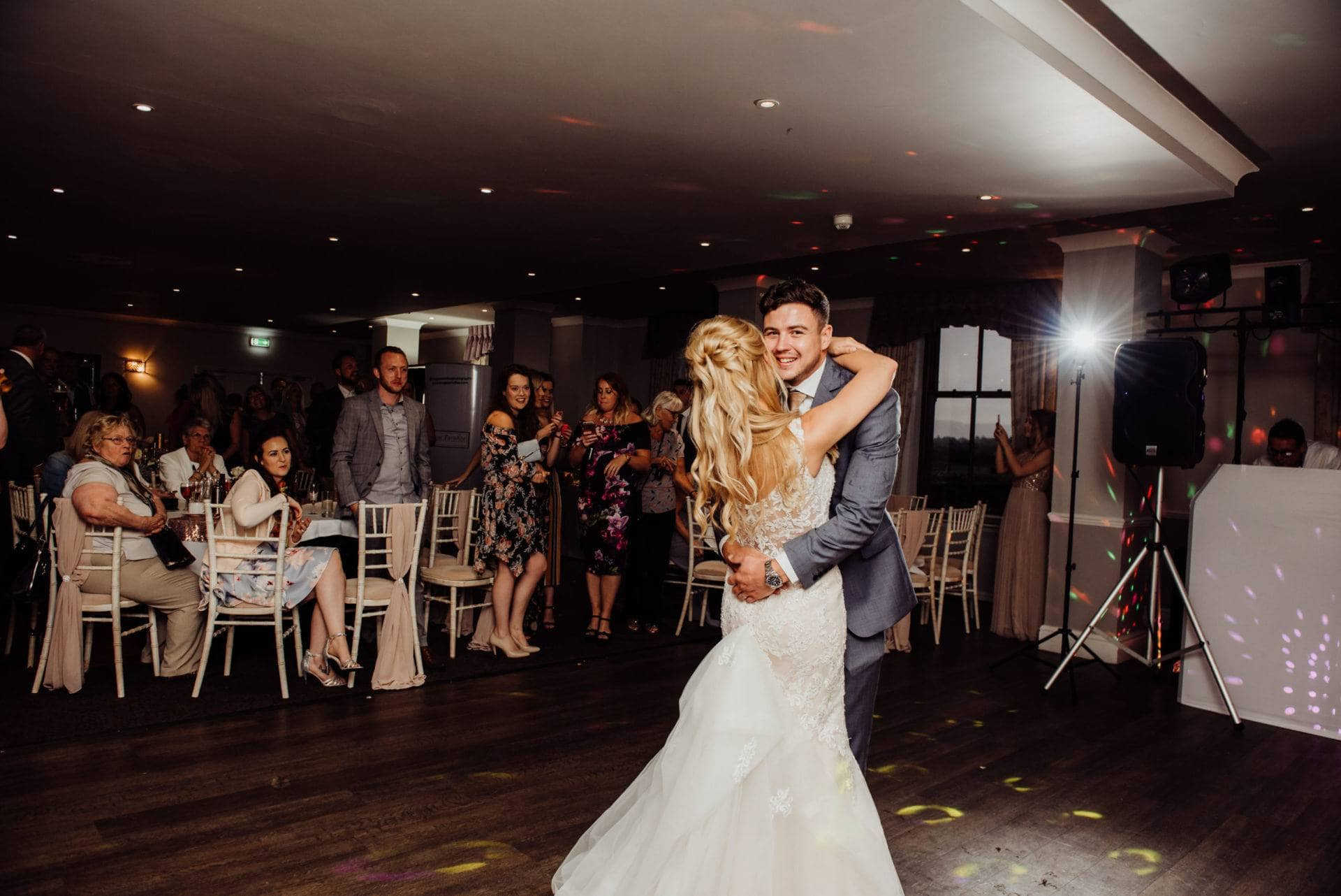 bride and groom share their first dance at Hatherley Manor
