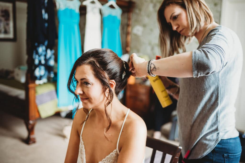 Bride has her wedding hair done in a room at the Walton Park hotel