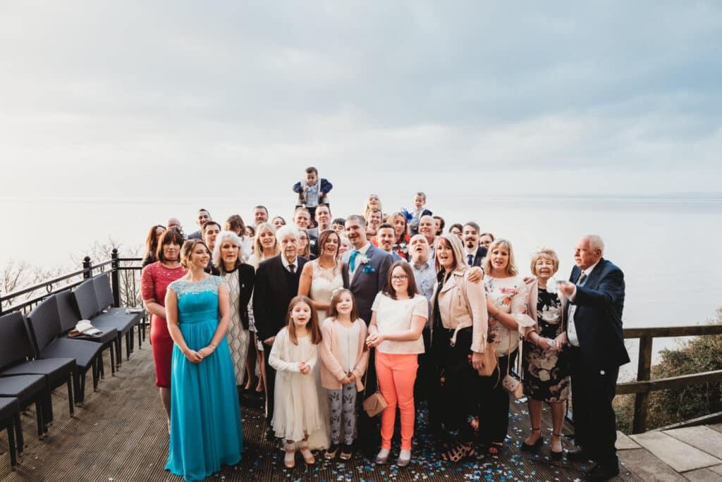 large wedding group photo on the balcony of the Walton park hotel